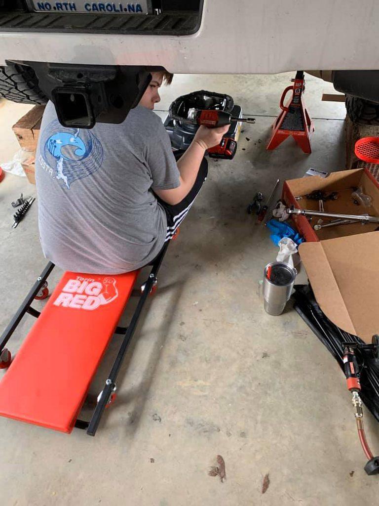 Brian Bland 2018 GMC Denali L5P Duramax - Son working on the truck
